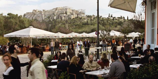 Athens, GREECE: Hundreds of Athenians and tourists enjoy their coffee and a walk in central Athens at...
