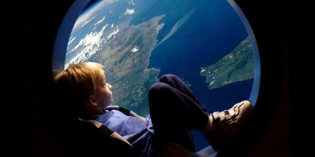 Little boy in a porthole,spaceship porthole, viewing earth,blonde boy,blue planet,conservation,window...