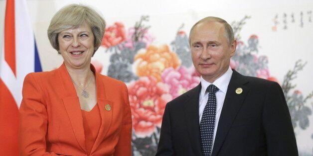 HANGZHOU, CHINA - SEPTEMBER 4, 2016: Russia's President Vladimir Putin (R) shakes hands with British...