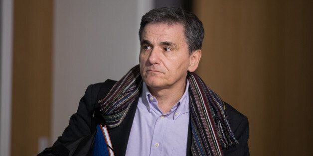 Euclid Tsakalotos, Greece's finance minister, departs from a Eurogroup meeting of euro-area finance ministers...
