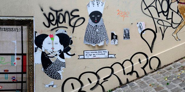 detail of graffiti painted illegally on public wall in