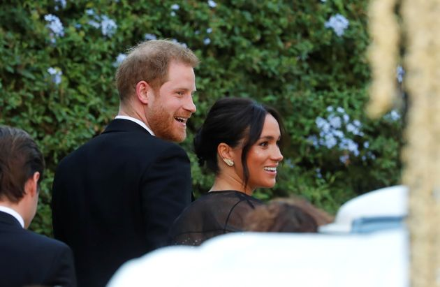 The Duke and Duchess of Sussex arrive to attend the wedding of fashion designer Misha Nonoo at Villa...