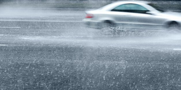 motion blur of driving car on a wet