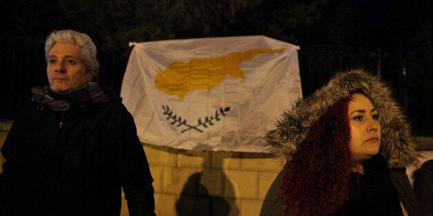 Greek Cypriots protest against the actions of President Nicos Anastasiades during the peace talks, outside...
