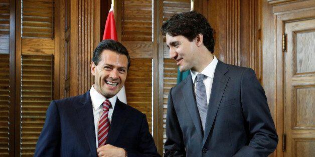 Canada's Prime Minister Justin Trudeau (R) meets with Mexico's President Enrique Pena Nieto in Trudeau's...