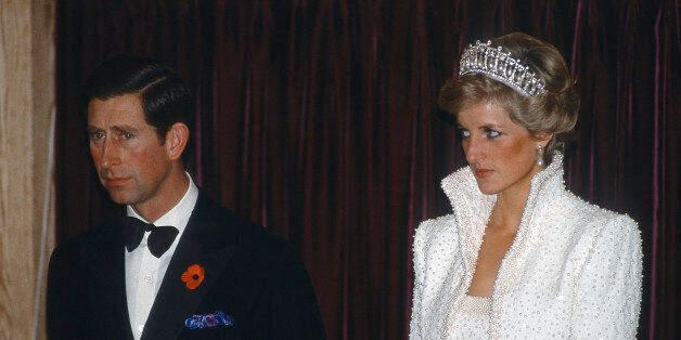 HONG KONG - NOVEMBER 10:  Prince Charles, Prince of Wales and Diana, Princess of Wales, wearing the Cambridge Lover's Knot tiara and a white outfit by Catherine Walker known as the 'Elvis Look', attend an event during a tour of Hong Kong on November 10,  1989 in Hong Kong. (Photo by Anwar Hussein/Getty Images)