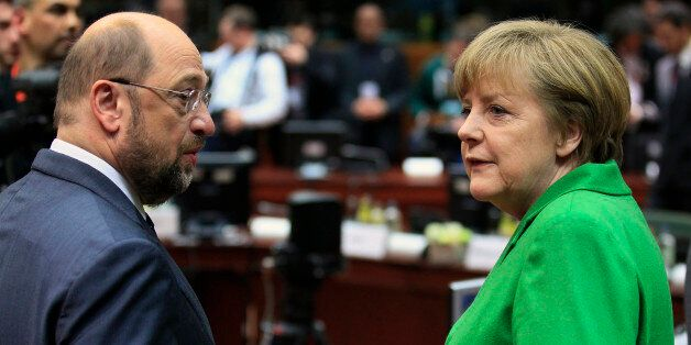 European Parliament President Martin Schulz (L) talks with Germany's Chancellor Angela Merkel at the...