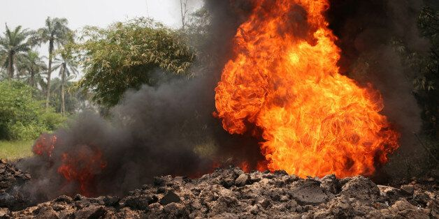 Fire burns on the Shell Petroleum Development Company Trans Niger pipeline (TNP) at Mogho, Gokana, Rivers...