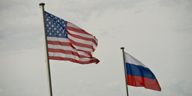Torgau, Germany - May 12: National Flags of USA and Russia on May 12, 2015 in Torgau, Germany. (Photo...