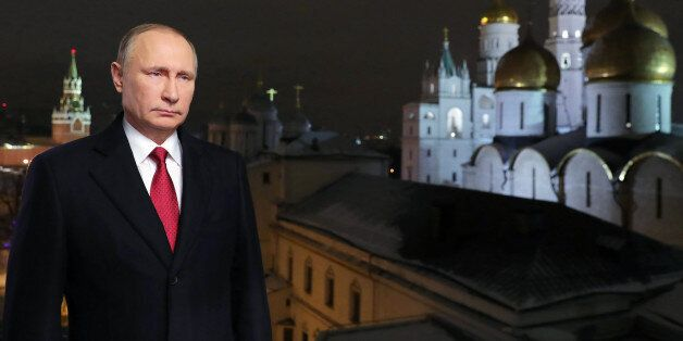 Russian President Vladimir Putin delivers his New Year's address to the nation in Moscow's Kremlin, December...
