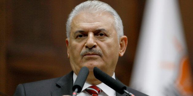 Turkey's Prime Minister Binali Yildirim addresses members of parliament from his ruling AK Party (AKP)...
