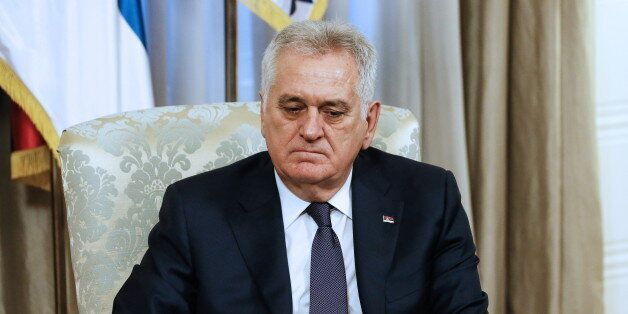 BELGRADE, SERBIA - DECEMBER 12, 2016: Serbia's President Tomislav Nikolic looks on during a meeting with...