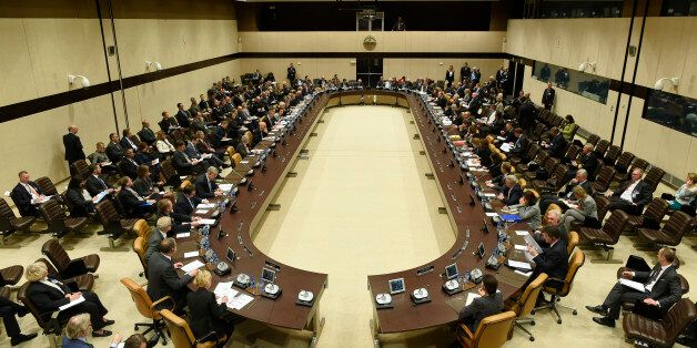 NATO Foreign ministers sit around a table during a Foreign Affairs meeting at the NATO headquarters in...