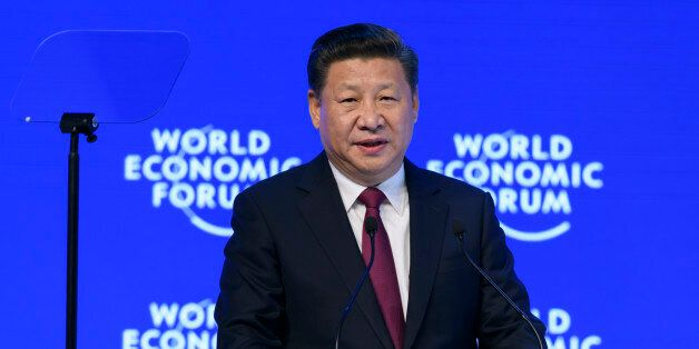 China's President Xi Jinping delivers a speech during the first day of the World Economic Forum, on January...