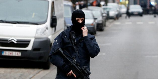 A female police officer stands guard at the scene of a security operation in the Brussels district of...