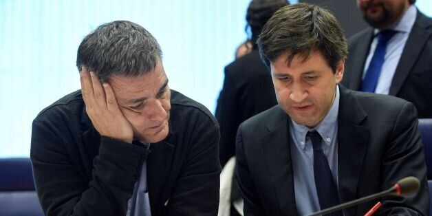 Greek Finance Minister Euclid Tsakalotos (L) listens to a Greek advisor during an Eurogroup meeting in...