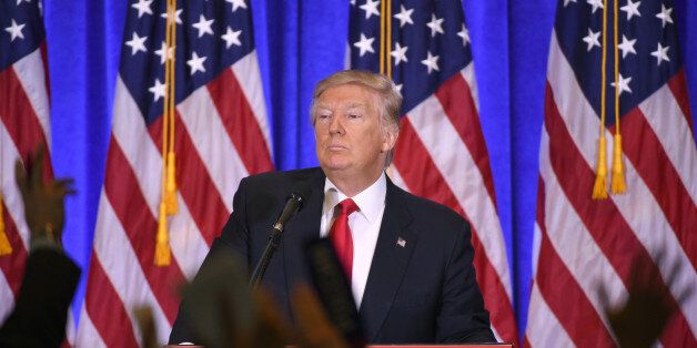 US President-elect Donald Trump answers journalists questions during a press conference on January 11,...