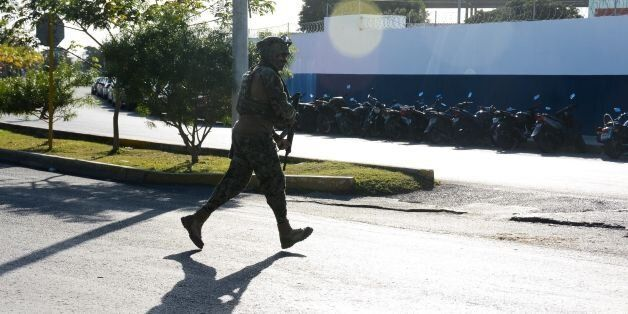 A marine arrives at the place where a shooting erupted after an attack against the building of the Quintana...