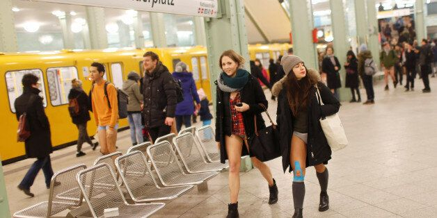 People take part in the annual 'No Pants Subway Ride' in Berlin, Germany, January 8, 2017. REUTERS/Hannibal