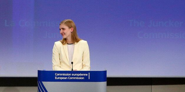 Jean-Claude Juncker (L), the incoming president of the European Commission (EC), presents the list of...