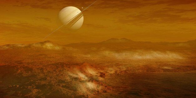 Saturn is seen here in the background from the enigmatic moon Titan, which is the second largest moon...