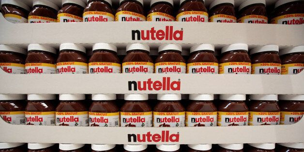Jars of Nutella chocolate-hazelnut paste are displayed at a Carrefour hypermarket in Nice, France, April...