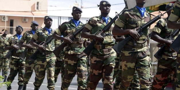 Soldiers parade during the closing ceremony of the three-week joint military exercise between African,...