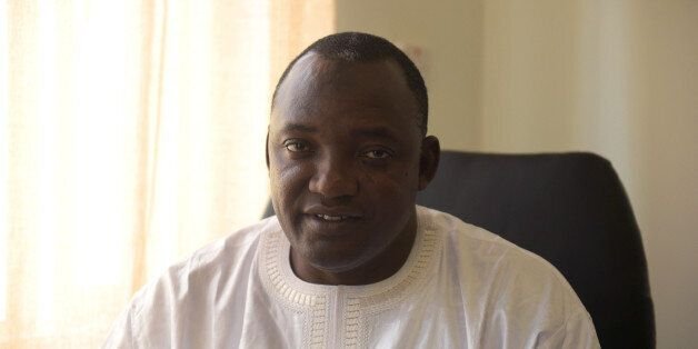 Gambia's President-elect Adama Barrow poses in his office in Serekunda, on December 11, 2016. Gambia's...