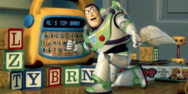 ATTENTION: THIS PICTURE HAS BEEN BINNED, DO NOT USE. UNDATED PUBLICITY PHOTO - FOR USE WITH STORY LEISURE-MOVIES - Buzz Lightyear uses a toy to plan a daring rescue of his pal Woody in Disney/Pixar's new computer animated comedy adventure film