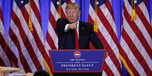 U.S. President-elect Donald Trump argues with a reporter during a news conference in the lobby of Trump...