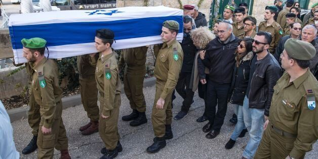 Israeli security forces carry the coffin of 20-year-old Israeli soldier Yael Yekutiel, on January 9,...