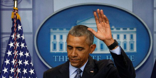 U.S. President Barack Obama waves as he departs the briefing room at the conclusion of his final press...