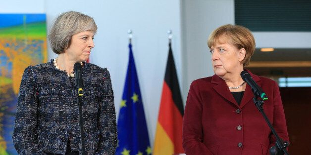 Theresa May, U.K. prime minister, and Angela Merkel, Germany's chancellor, pause during a news conference...