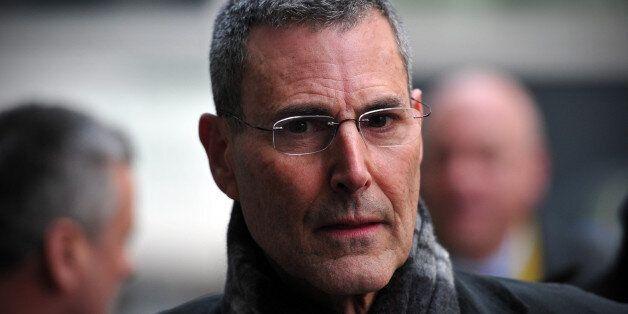 Israeli entertainer Uri Geller arrives to attend a hearing in civil cases taken against Rupert Murdoch's...