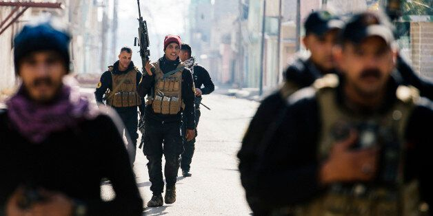 Members of the Iraqi special forces Counter Terrorism Service (CTS) patrol in Mosul's al-Jazair neighbourhood...