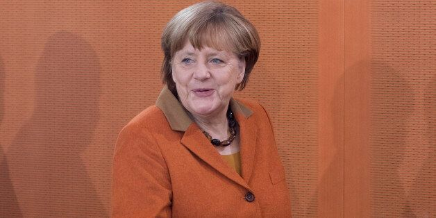 German Chancellor Angela Merkel arrives to open the weekly cabinet meeting at the Chancellery in Berlin...