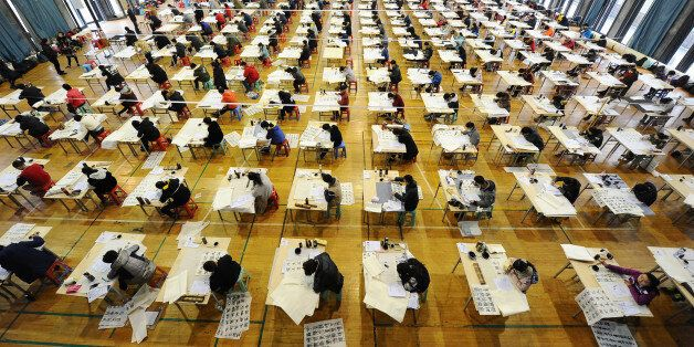 HANGZHOU, CHINA - FEBRUARY 19: (CHINA OUT) Students take part in the four-day recruitment test for the...