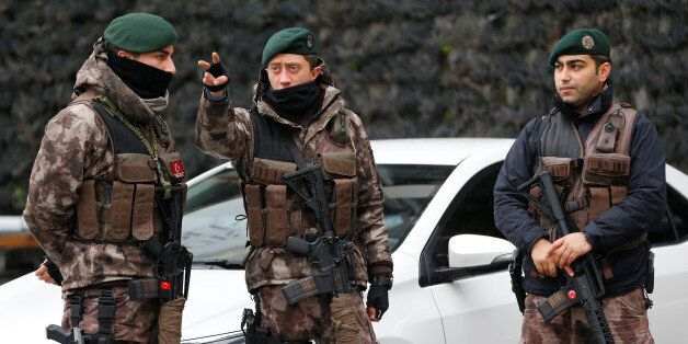 Members of the Turkish police special forces stand guard at the police headquarters in Istanbul, Turkey,...