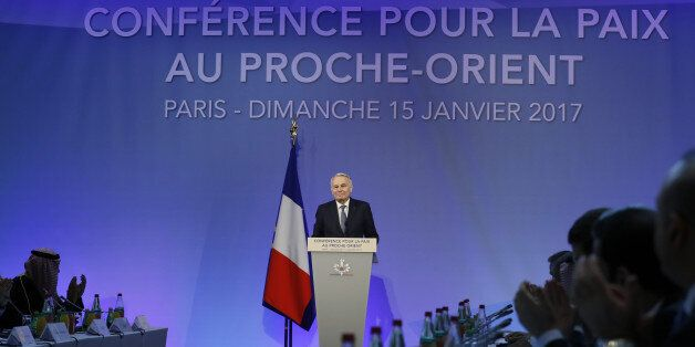 French Minister of Foreign Affairs Jean-Marc Ayrault addresses delegates at the opening of the Mideast...