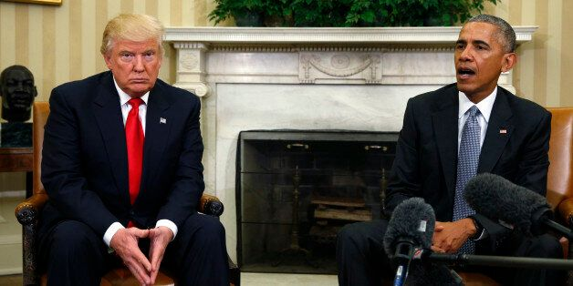 U.S. President Barack Obama (R) speaks while meeting with President-elect Donald Trump to discuss transition...