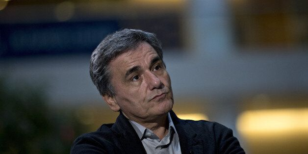 Euclid Tsakalotos, Greece's finance minister, listens to a question during a Bloomberg Television interview...