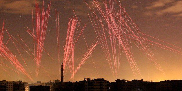 DAMASCUS, SYRIA - JANUARY 01: Lights illuminate the sky after regime forces' gunfires into the air during...