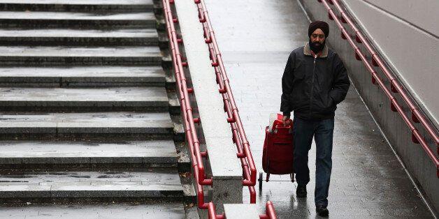 VIENNA, AUSTRIA - DECEMBER 01: A man wearing turban walks on the street on December 1, 2016 in Vienna,...