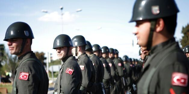 Turkish soldiers take part in a military parade during celebrations marking the 33rd anniversary of the...