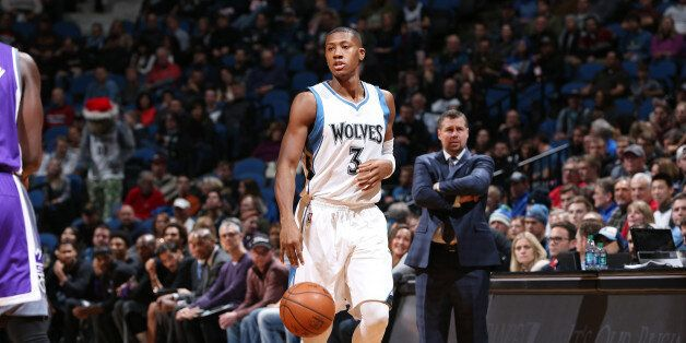 MINNEAPOLIS, MN - DECEMBER 23: Kris Dunn #3 of the Minnesota Timberwolves brings the ball up the court...