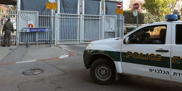 An Israeli police car is seen at the entrance to the residence of Israeli Prime Minister Benjamin Netanyahu...
