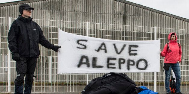 Participants of the solidarity march to Aleppo hold a banner reading 'Save Aleppo' in Berlin,Germany,...
