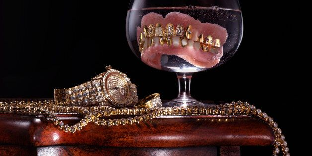 Dentures with precious stones in glass by jewelry and