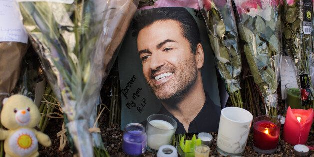 LONDON, ENGLAND - DECEMBER 28: Tributes of flowers, photographs and candles are left outside the home...
