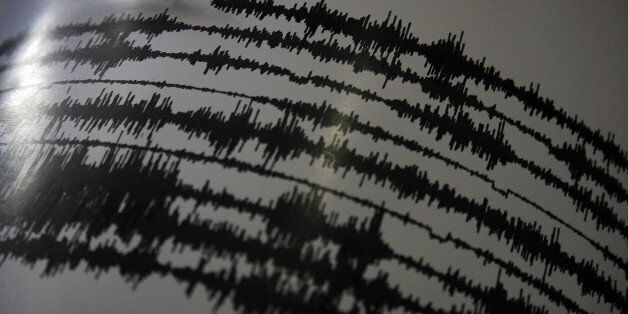 An image stored on March 7, 2015 shows a seismograph record of volcanic activity of Mount Sinabung in...